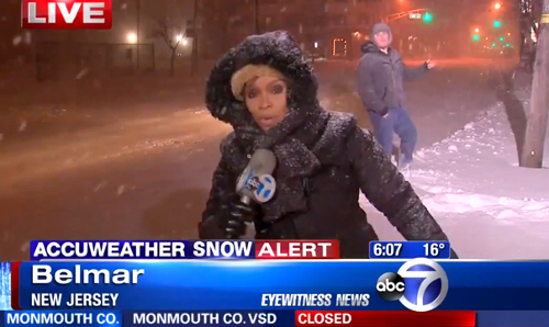 Reporter in snow